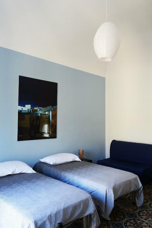 Dormitorio con 2 camas de 90 con sofá cama
