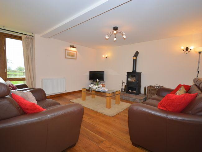Spacious lounge with added woodburner for cosy winter nights