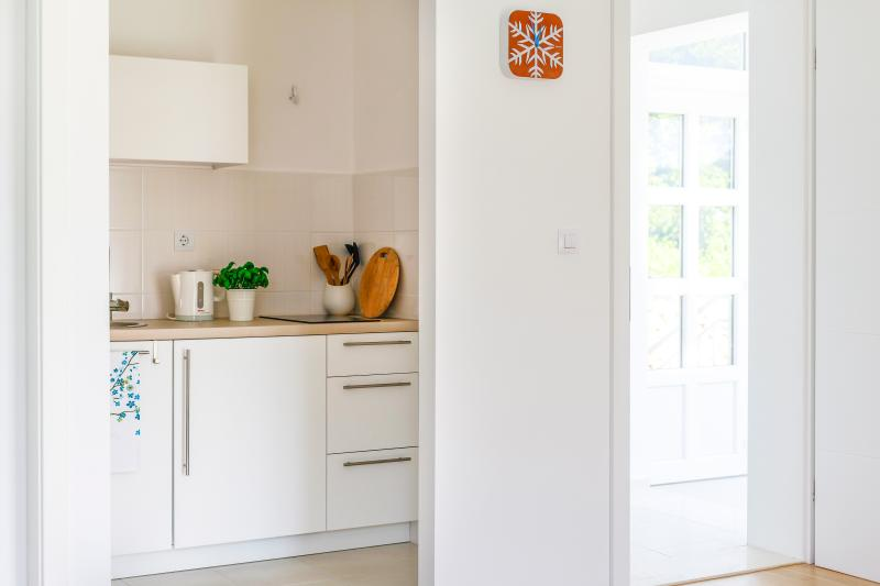 Kitchenette and exit/entrance of the studio apartment