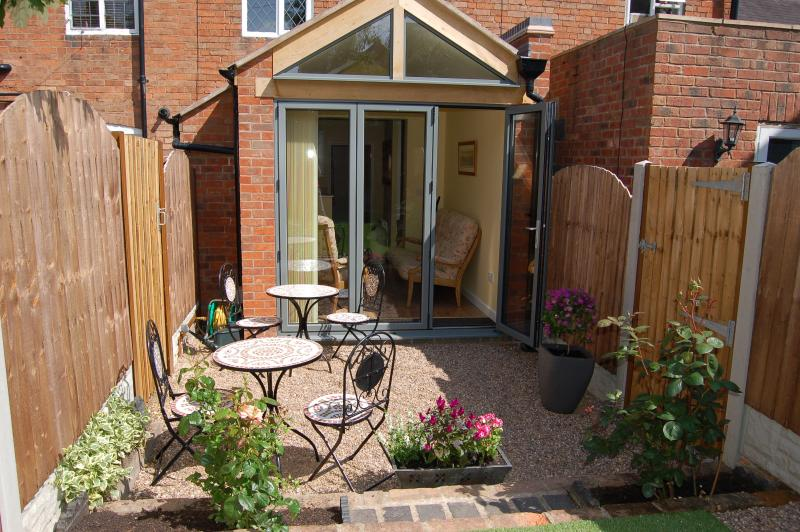 From patio to back of cottage