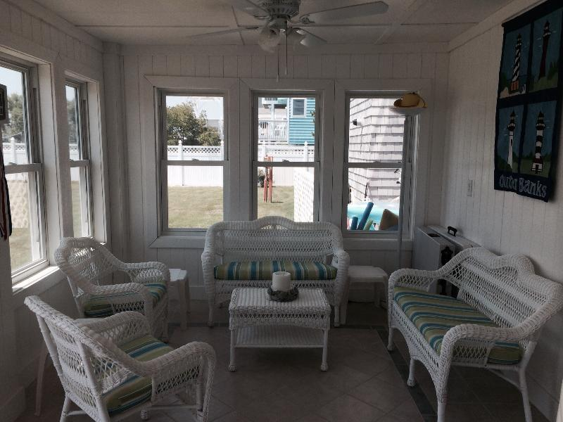 Social area on Lower level leading to backyard - this level has small kitchen, rec room and sun room