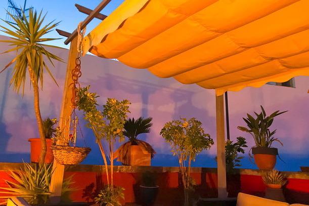 Nightfall over terrace/ cocktail bar