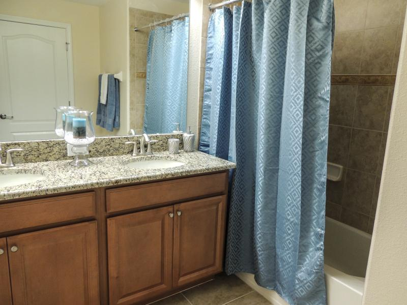 The ensuite master has a tub shower and water closet along with two sinks and granite countertops.