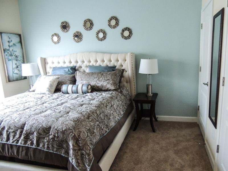 The main floor master has a King bed, closets, large TV, fan and adjacent bath.