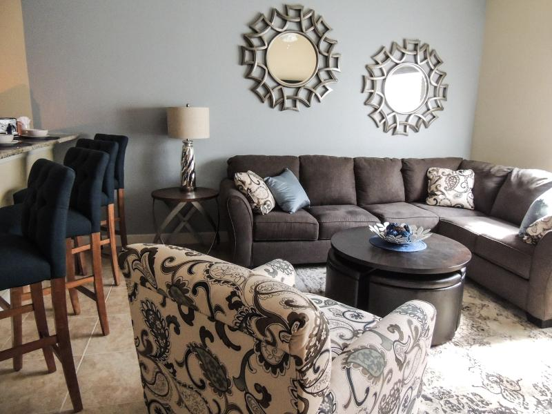Relax in the comfy couch and enjoy a selection of movies or netfix on the large TV.