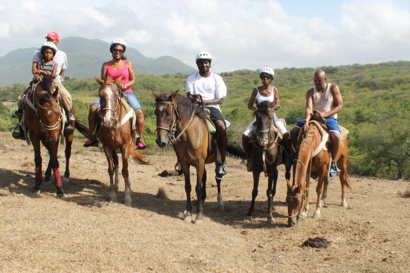 Guests horseback riding excursion
