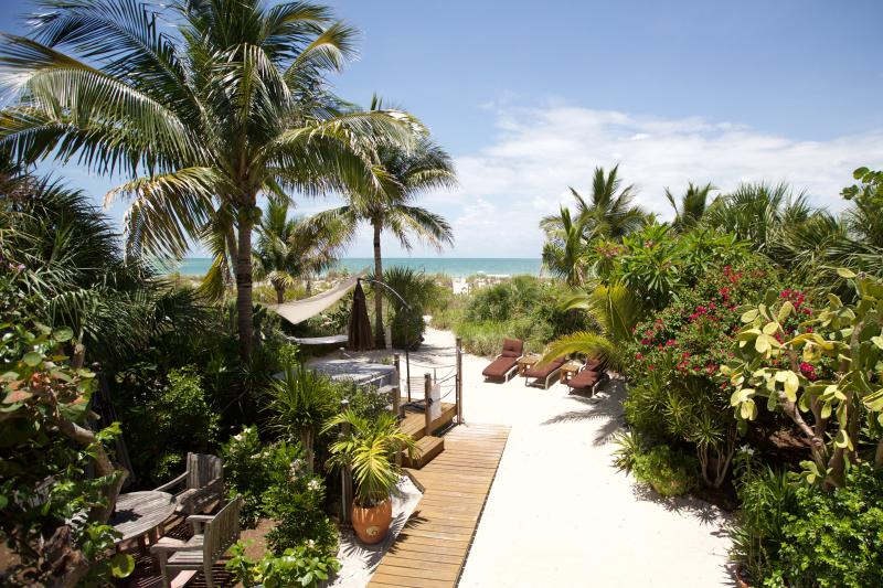 Just a step off the deck and your in white pristine sand!