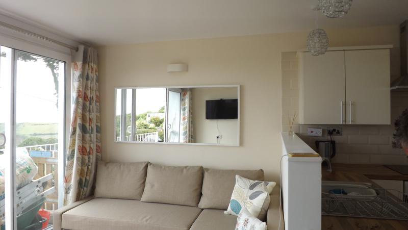 Open plan living area with Double Sofa Bed and large Flat Screen TV with Freeview
