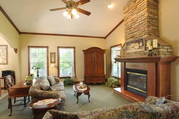 Living room: comfortable common area features fireplace and large TV