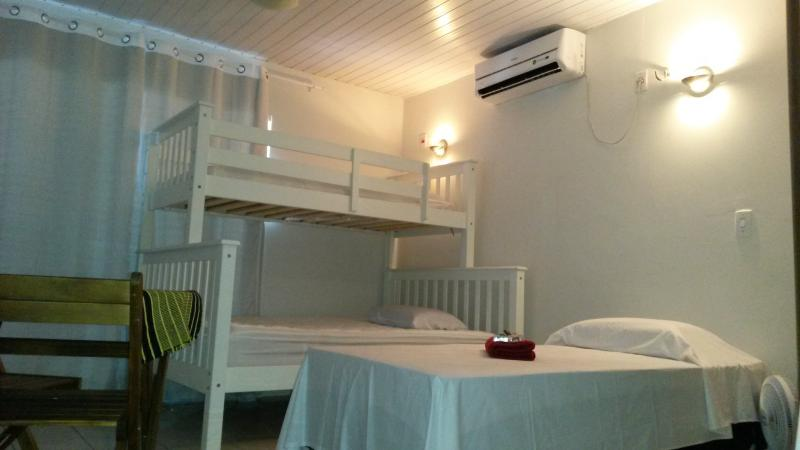 double bed with single bunk and a twin bed