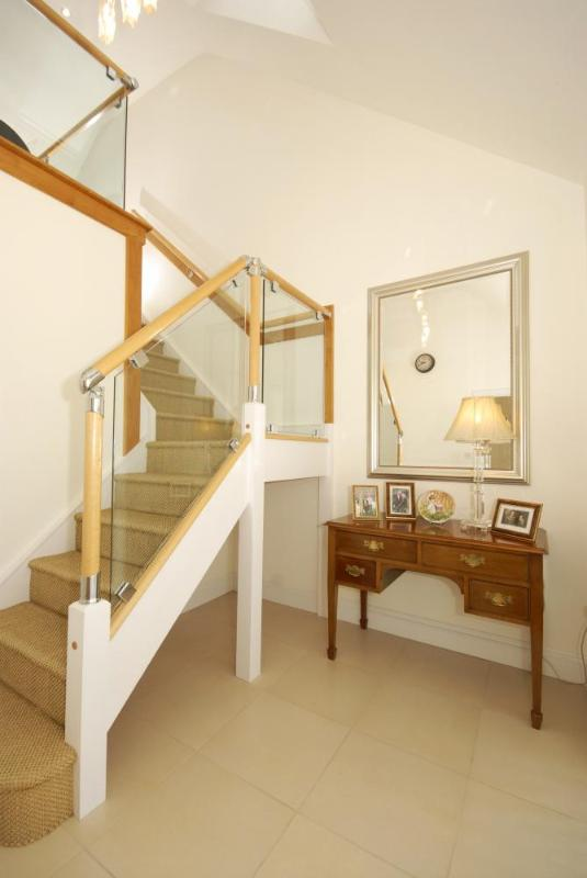 Hallway with bespoke staircase to the galleried landing