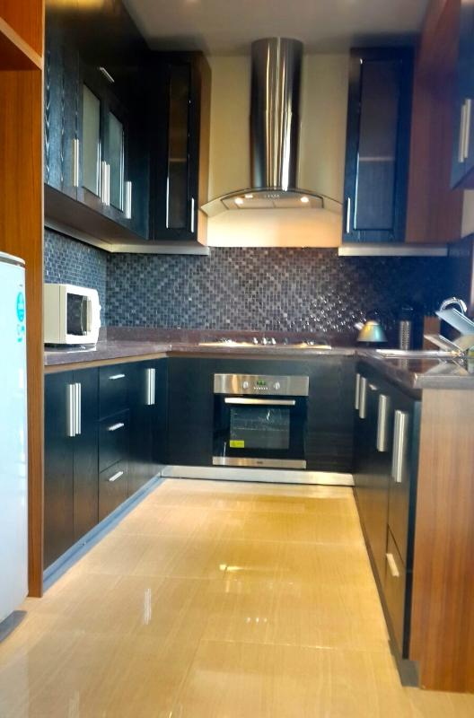 Very Modern Western kitchen with  direct access to one of two decks