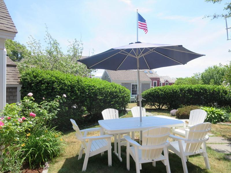 The Captains House with outdoor table and chairs - 51 Eliphamets Lane Chatham (Captains House) Cape Cod New England Vacation Rentals