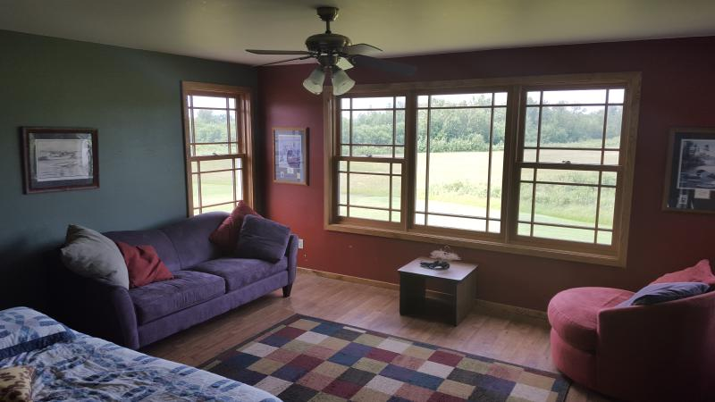 Upper floor sitting room with plenty of windows to enjoy the private wooded views and wildlife