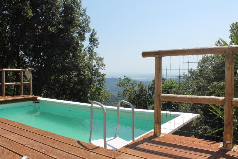 the swimming pool with panorama of the sea and coast