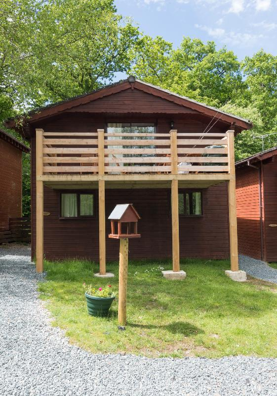 Two storey lodge situated in woodland, overlooking the lakes