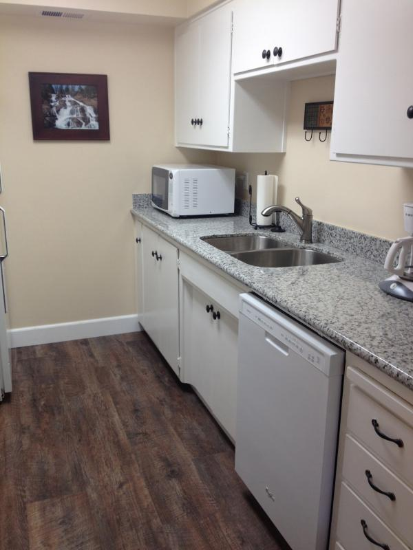 Kitchen updates also feature new appliances, stove and oven, quiet dishwasher, generous sink!