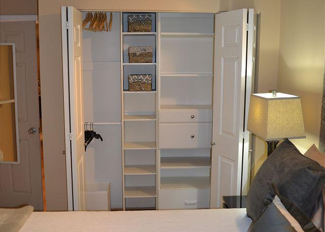 large organized closet in bedroom