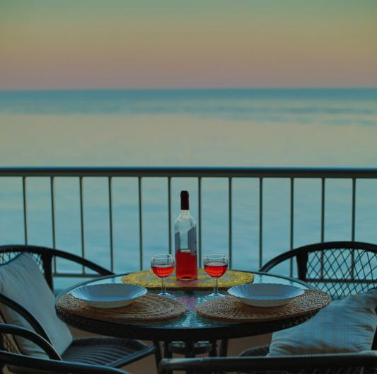 Relax with a glass of wine after a day on the beach