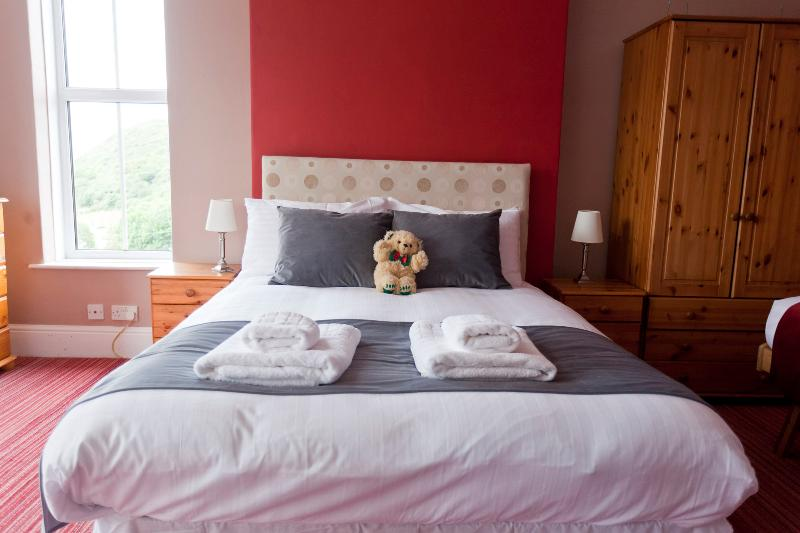 Family Bed room 2, sleeps 4 (one double bed plus 2 singles) with sea views