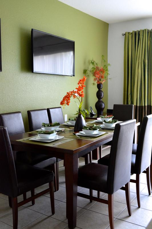 Beautifully appointed dinning room with leather seats and large LCD screen