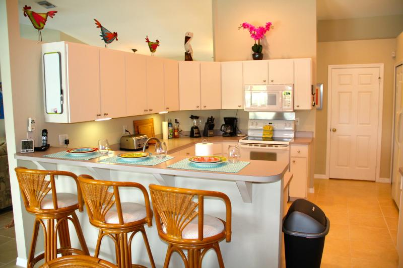 Fully equipped large kitchen w/bar seating area make preparing meals a pleasure.