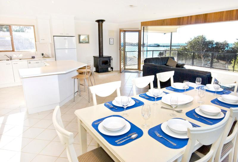 The dining room situated in the spacious living area with views to the beach