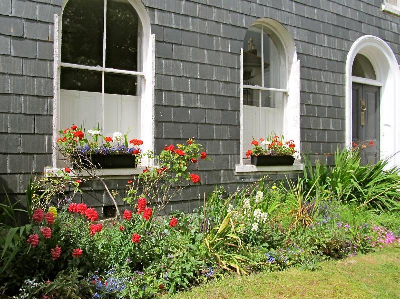 This Stylish Luxury Apartment Overlooks The Front Garden.