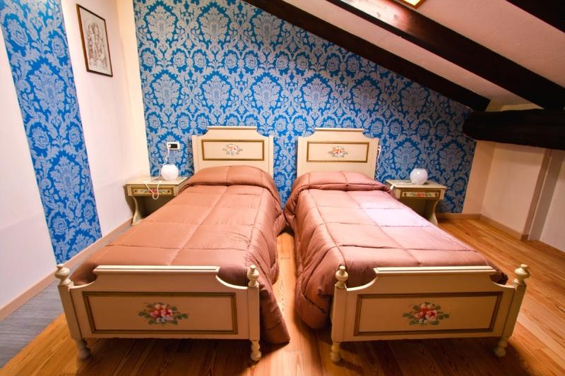 Blue room with 2 single beds