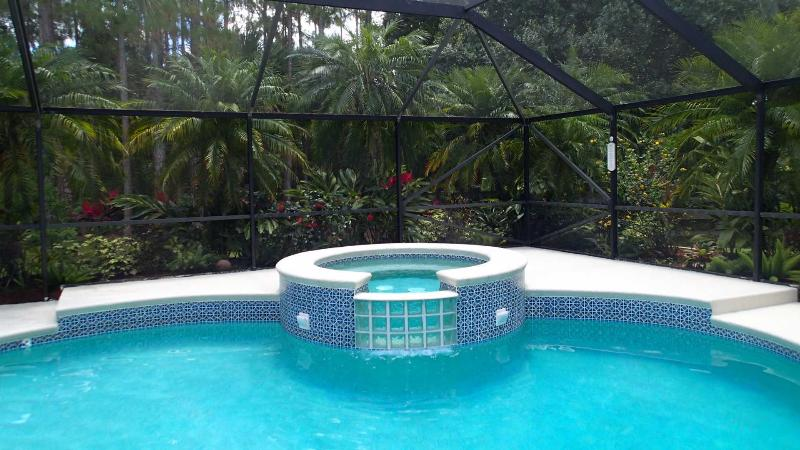 Shadey Acres. Relax in luxury in our fully screened heated pool and bubbling spa!