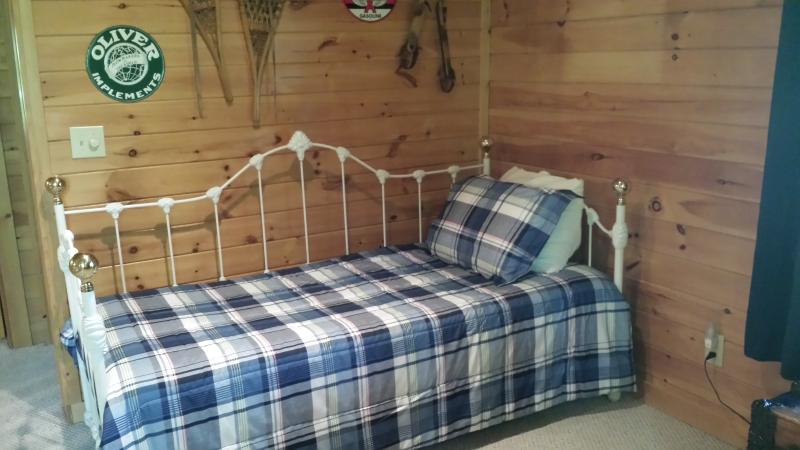 Twin bed with pull-out trundle in loft