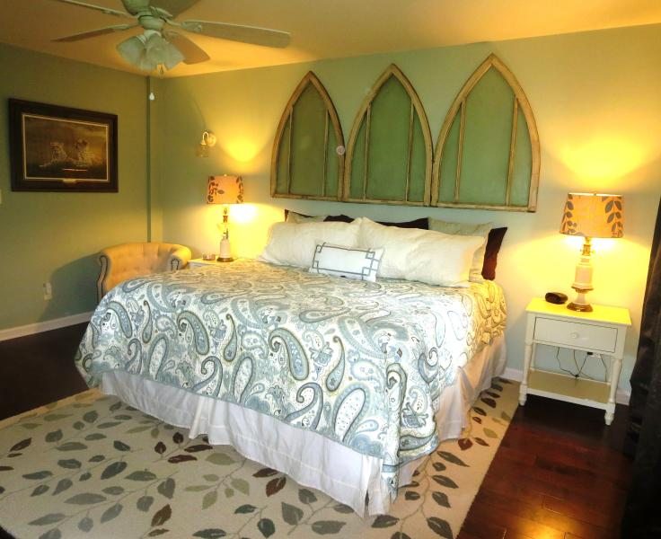 The lower level bedroom has a king bed, along with comfy chairs for reading and TV.