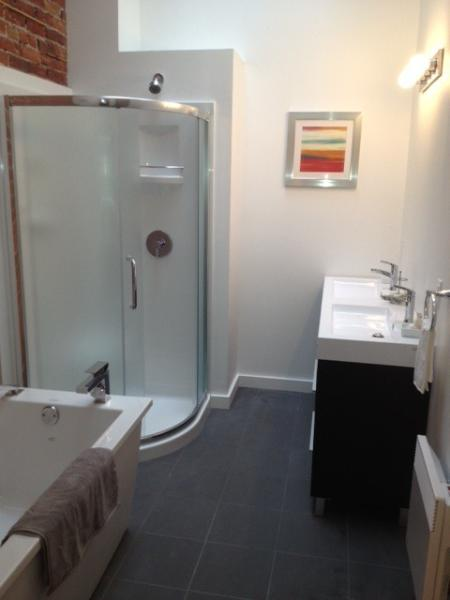 Bathroom with shower and seperate bath and 2 sinks and toilet. All towels and included.