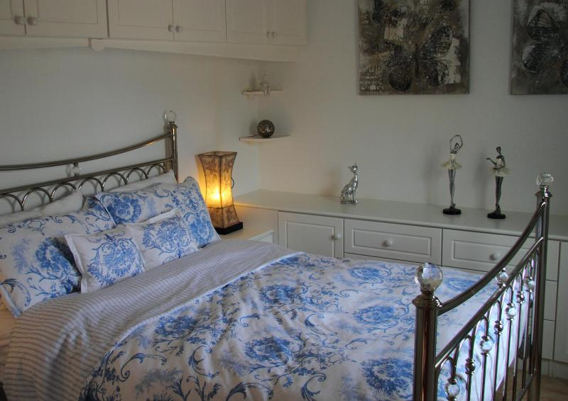 Upstairs king-size bed with quality Dorma linen.