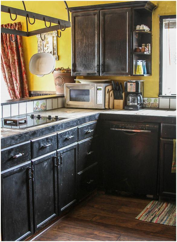 Full kitchen with appliances, dishes, plates, cookware, double over, microwave, dishwasher.