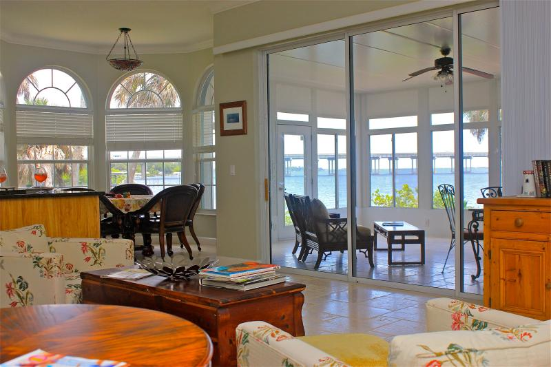 Expanse windows to view the panoramic landscape from iving room to lanai.