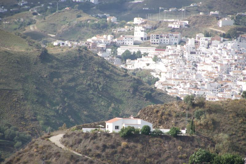 The villa and the village of Almachar behind