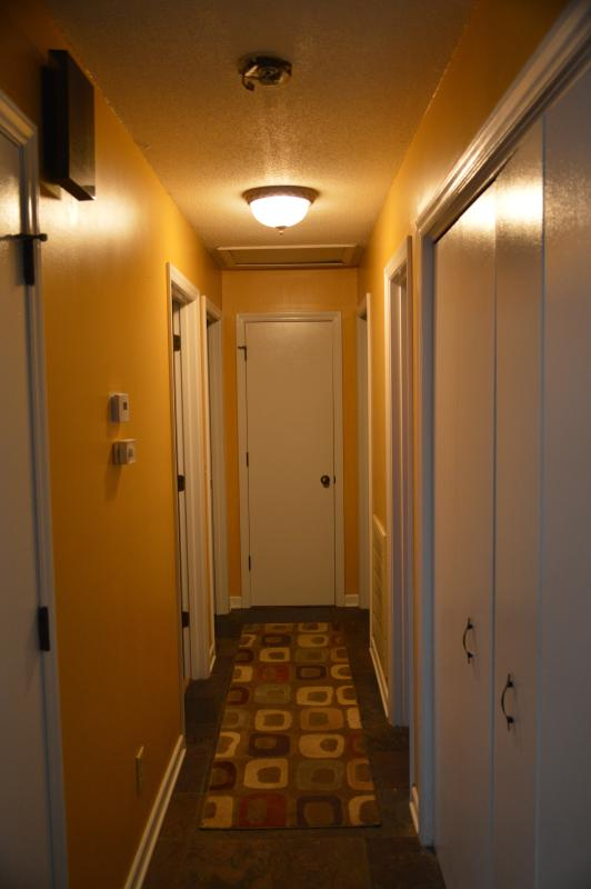 The main hallways, with the thermostat to the air conditioner and the washer/dryer.