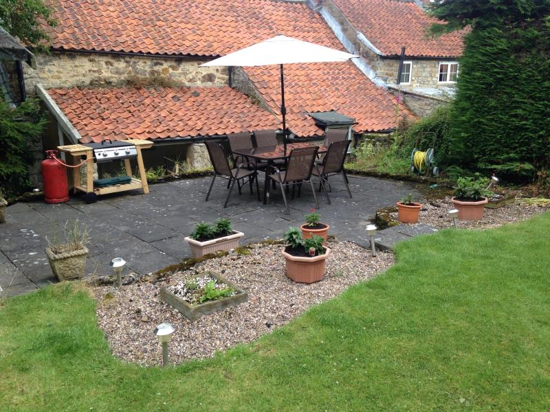 Patio area complete with barbecue and patio set seating for 6 also summer house for those rainy days