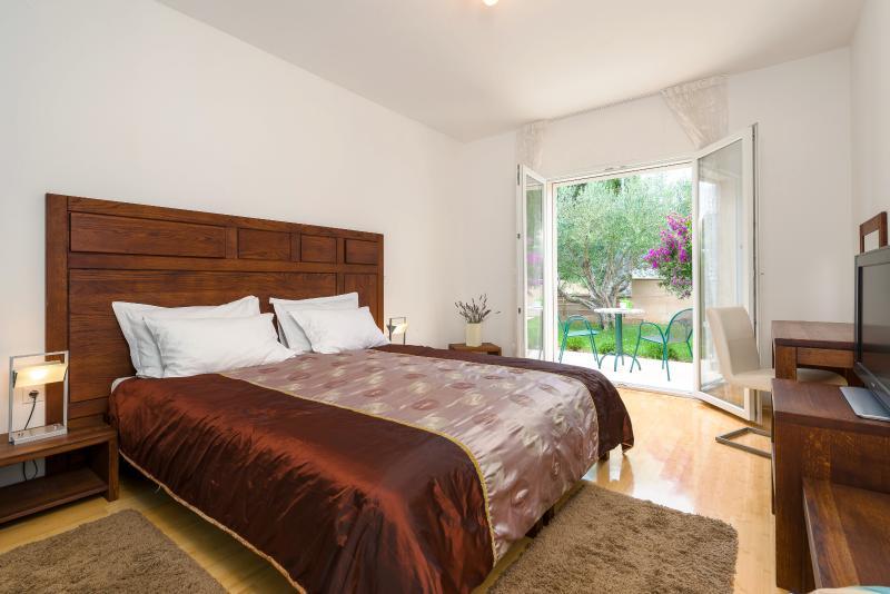 Ground floor double bedroom with terrace