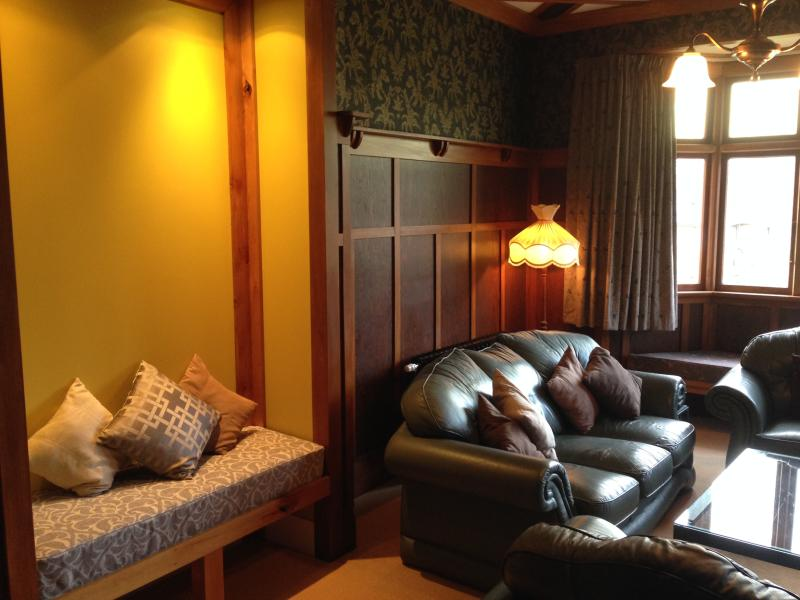 Lounge with plenty of comfy seating, wood burner, books and games