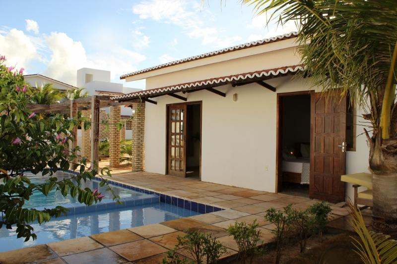 Welcome to Casa Jardim Pergola.  Landscaped garden, private pool shaded by a large pergola area.