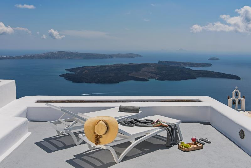 Sunbathing terrace with sea, volcano view and sunset view