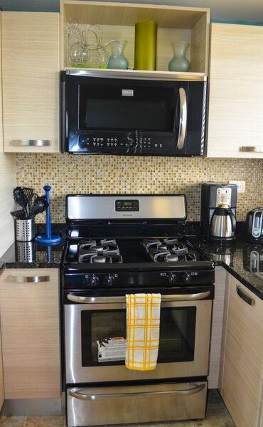 Kitchen - gas range with over the range microwave