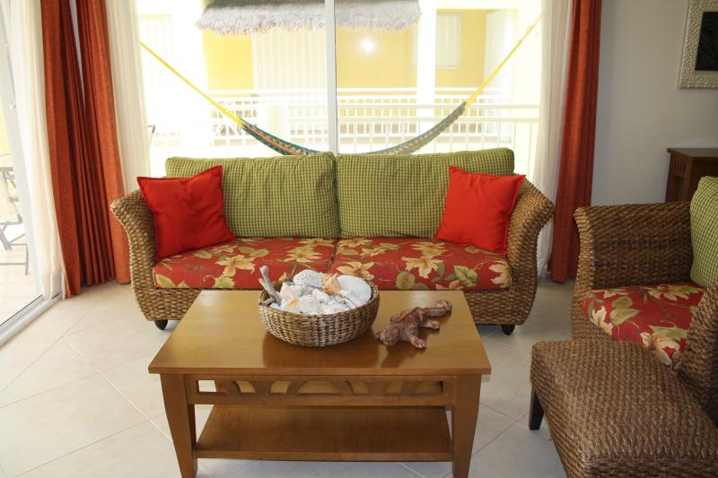 Tropical style living area with TV, Internet, Wifi, Cable and games/music.