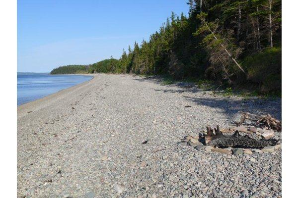 down at the beach of the log cottages