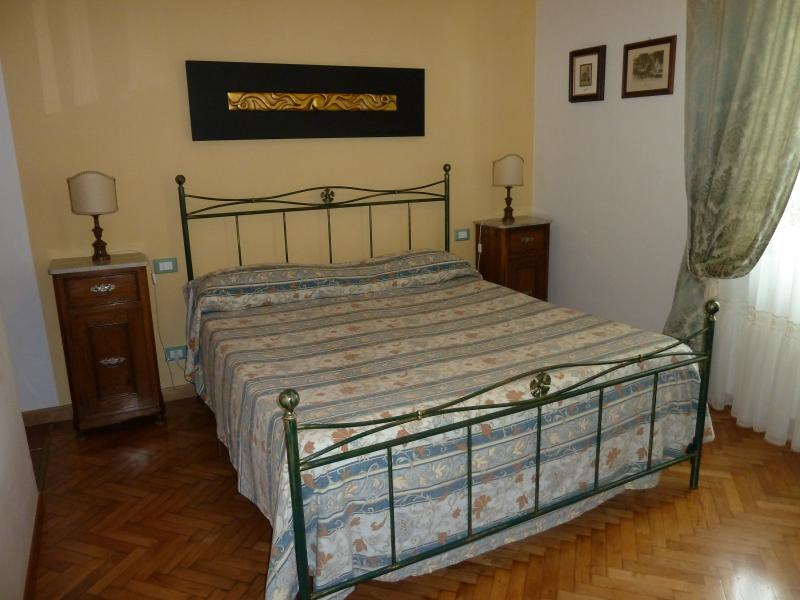 The bed in the master bedroom