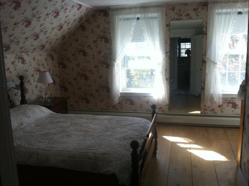 Matts bedroom with queen bed listen to the river at night from front windows