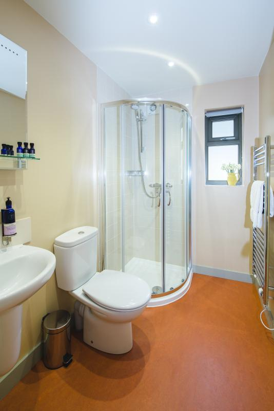 One of our en-suite bathrooms with a selection of products from Neal's Yard Remedies