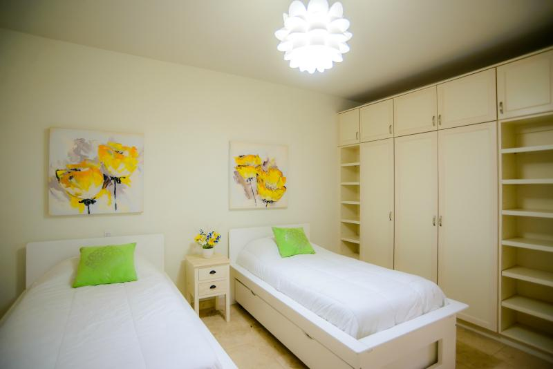 Second bedroom with two twins beds.